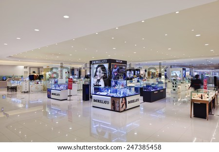 SHANGHAI-DEC. 8, 2014. Luxury shopping mall interior. China accounts for about 20 percent, or 180 billion renminbi ($27 billion1 ) of global luxury sales in 2015, according to new McKinsey research. - stock photo