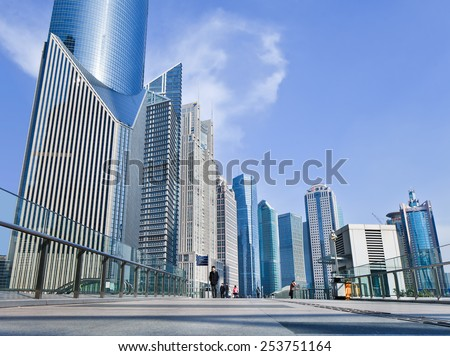SHANGHAI-DEC. 2, 2014. Skyscrapers at Lujiazui, a national-level development zone designated by government. In 2005, State Council reaffirmed positioning of Lujiazui area as finance and trade zone. - stock photo