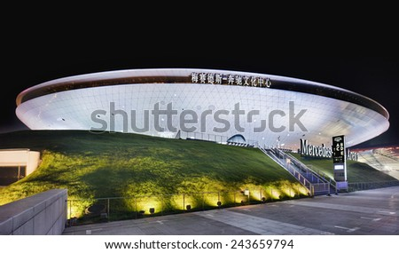 SHANGHAI-DECEMBER 7, 2014. Mercedes-Benz Arena at night. It is the former World Expo Cultural Center, facility which accommodates 18,000 people, hosted the opening ceremony for World Expo in 2010.  - stock photo