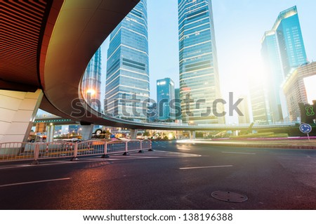 shanghai downtown at night with roundabout light trails - stock photo