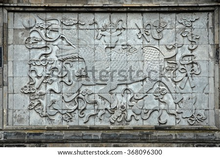 Shanghai, dragon sculpture at the Xitang town main entry. - stock photo