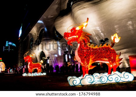 Shanghai - FEB 14: Dragons light figure in Lantern Festival at Zendai Himalayas Center Shanghai on Feb 14, 2014 in Shanghai, China. Lantern festival date this year is  same with Valentine day. - stock photo