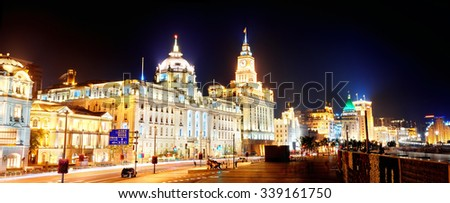 Shanghai historic architecture panorama at night on street with lights. - stock photo