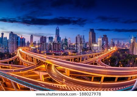 shanghai interchange overpass and elevated road in nightfall - stock photo