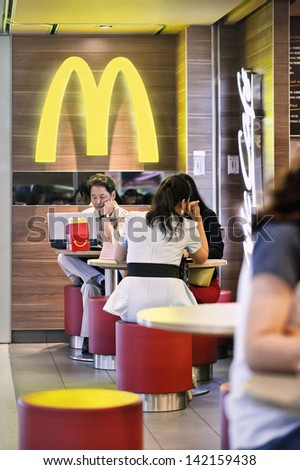 SHANGHAI-JUNE 11. McDonald outlet, Hongqiao Airport. It took McDonald 19 years to reach 1,000 restaurants in China, the fast food giant want to double this to 2,000 this year. Shanghai, June 11, 2013 - stock photo