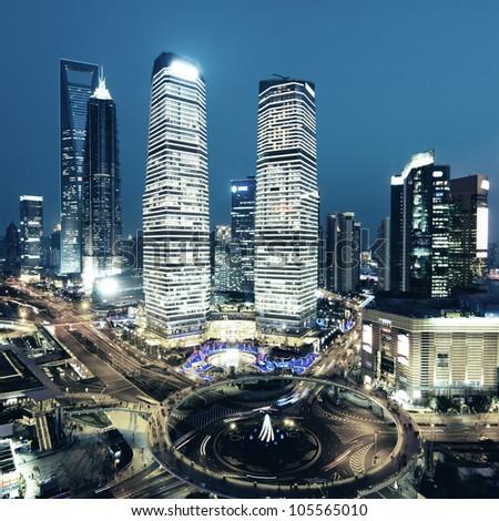 shanghai lujiazui financial center in the evening - stock photo