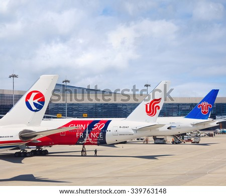 SHANGHAI-MAY 6, 2014. Airplanes from China Eastern, Air China and China Southern Airlines on Hongqiao Airport. First quarter of 2015 traffic from Chinas airlines surpassed 100 million passengers. - stock photo