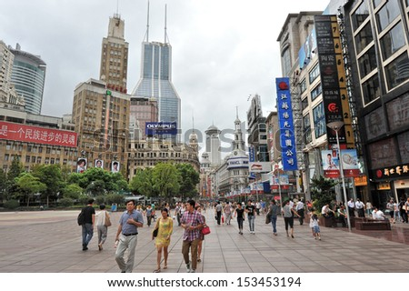 SHANGHAI - MAY 2: Chinese tourist sites attract huge crowds of people during May Holiday on May 2, 2013 in Shanghai, China. Here at Nanjing Lu commercial tourist street. - stock photo