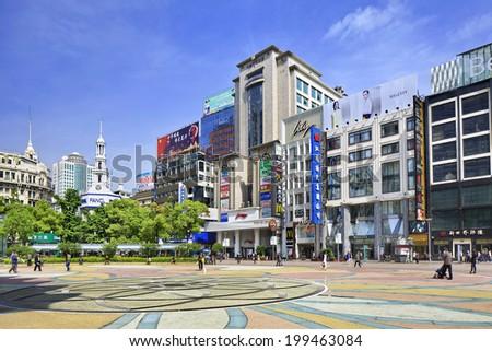 SHANGHAI-MAY 5, 2014. Nanjing East shopping street. Nanjing Road is the main shopping street of Shanghai, China, named after the city of Nanjing, capital of Jiangsu province neighboring Shanghai. - stock photo
