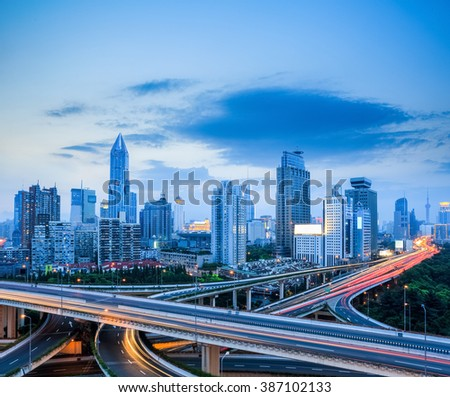 shanghai modern skyline with city interchange overpass in night falls