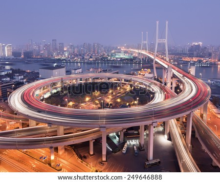 Shanghai Nanpu bridge over the Huangpu river at twilight.  - stock photo