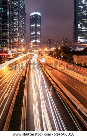 shanghai night view in lujiazui financial and trade zone,city road with modern buildings, China