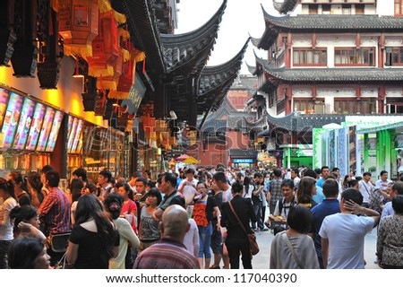 SHANGHAI - OCT 5: tourists visit Yuyuan garden during Chinese National Day holiday on October 5, 2012 in Shanghai, China. During this holiday around 740 million trips will be made by Chinese people. - stock photo