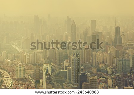 "SHANGHAI - OCT 8: view of heavily polluted city center on October 8, 2014 in Shanghai, China. Air quality index levels were classed as ""Beyond Index"" (PM 2.5 of over 500 micrograms per cubic meter).  - stock photo"
