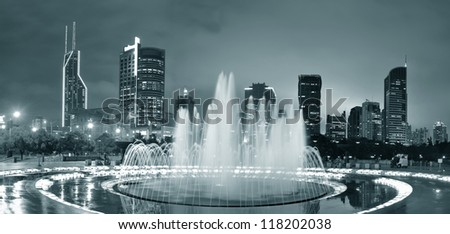 Shanghai People's Square with fountain and urban skyline at night panorama in black and white - stock photo