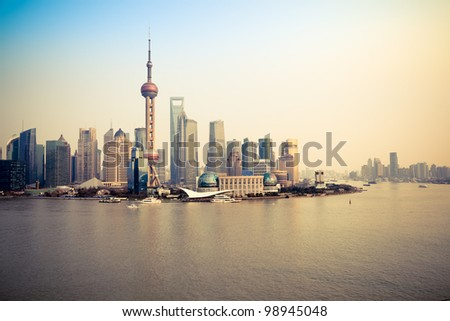 shanghai pudong skyline and huangpu river at dusk - stock photo