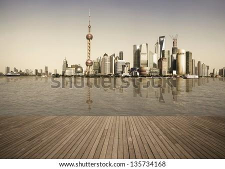 Shanghai's landmark skyline prospects of wood floor corridor at urban buildings landscape - stock photo