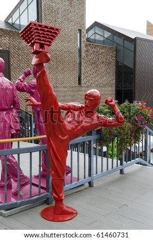 SHANGHAI - SEPT 1: WORLD EXPO Statue of  Famous Hong Kong action actor Bruce Lee. Sept 1, 2010 in Shanghai China - stock photo