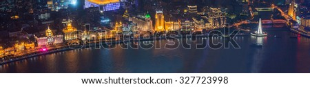 SHANGHAI-September 24, 2015?Bund or Waitan waterfront at night. Shanghai waterfront Bund has historical buildings and it is one of the most famous tourist places in Shanghai. - stock photo
