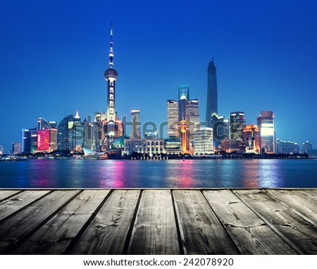 Shanghai skyline and wooden platform - stock photo