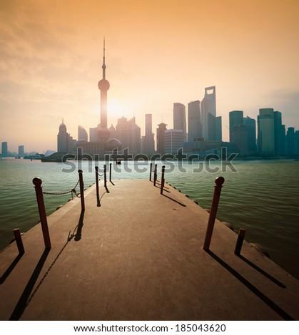 Shanghai skyline at sunrise dawn Pier - stock photo