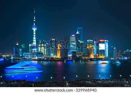 Shanghai skyline by night with Huangpu river  - stock photo