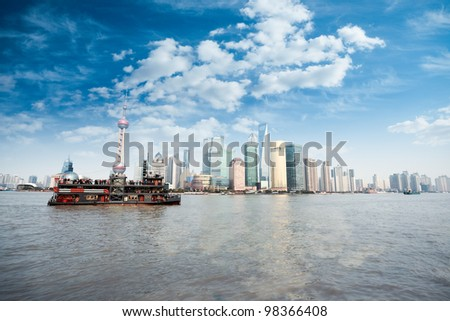 shanghai skyline in daytime,lujiazui finance and trade zone against a blue sky - stock photo