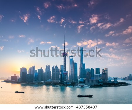 shanghai skyline in sunrise , the rosy colour of dawn spreads all over the sky.