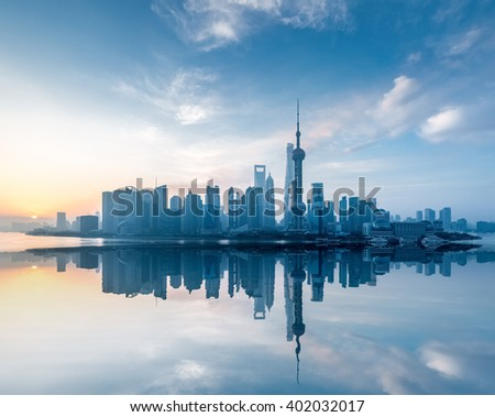 shanghai skyline with reflection in sunrise , China