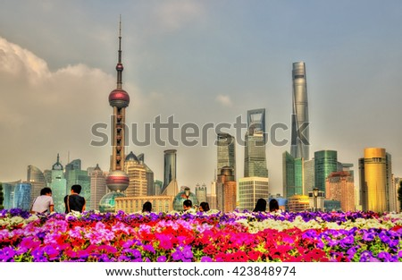 Shanghai skyscrapers as seen from the Bund Riverside - China - stock photo