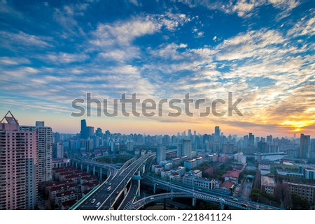shanghai yanan west road intersection at dusk ,modern city skyline and transport - stock photo