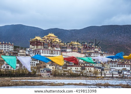 Shangrila. Ganden Sumtseling Monastery. Tibetan Buddhist monastery in Yunnan province, China. The monastery is the largest Tibetan Buddhist monastery in Yunnan province - stock photo