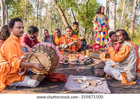 SHANTINIKETAN, INDIA - DECEMBER 26: An Indian traditional baul folk band performs during the annual Poush Mela fair on December 26, 2015 in Shantiniketan, West Bengal, India.