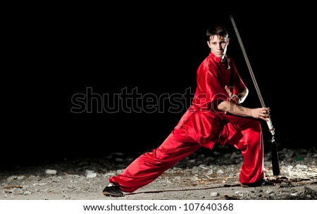 Shaolin warriors wushoo man in red practice martial art outdoor. Kung fu - stock photo