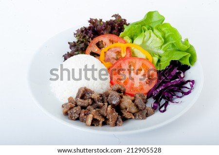 shaorma chicken on a plate with rice and salad,Peruvian Lomo Saltado dish,Gyro doner garnished with rice pilaf and vegetables served on thin lavash bread,Hot cutlets with asparagus, tomato and lettuce - stock photo