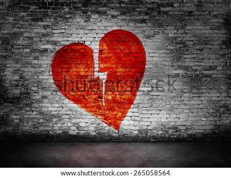 Shape of broken heart on murky brick wall  - stock photo
