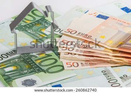 Shape of house and money - stock photo