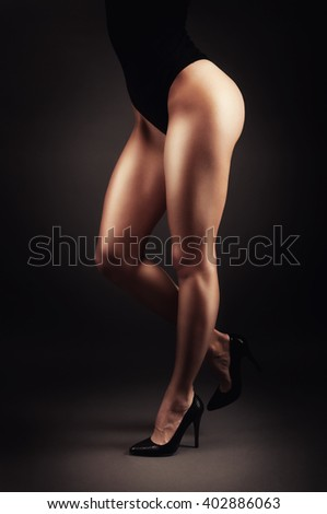 Shaped female legs in high heels sculpted in muscles