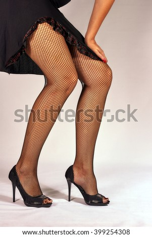 Shapely legs in black stockings