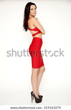 shapely silhouette beautiful young adult slim sexy and attractive sensuality pretty brunette woman in red elegance dress isolated on white background