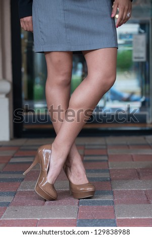 Shapely well toned legs, and brown high heel shoes.