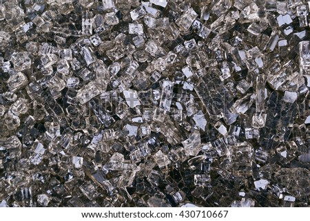 Shards of broken glass. Particles of shattered glass. Filled full frame. Place for your text.  Crushed glass background.