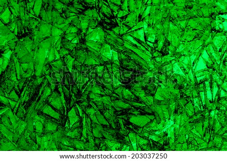 Shards of broken green ice on lake for background - stock photo