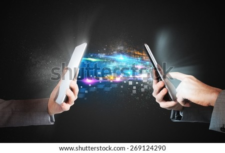 Share and send media files between phones - stock photo