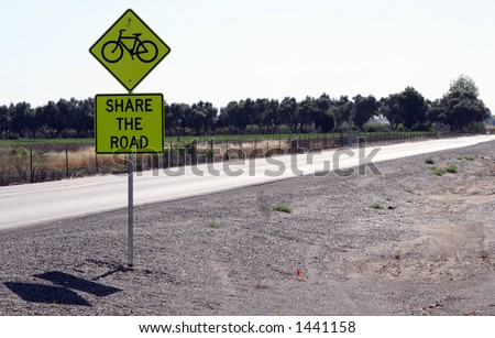Share the Road street sign. - stock photo