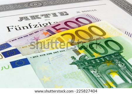 Share with fanned out Euro banknotes - stock photo
