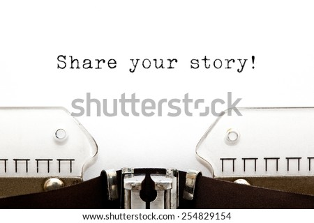 Share Your Story typed on a old typewriter. - stock photo