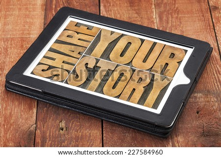 share your story word abstract  - isolated text in vintage letterpress wood type on a digital tablet against rustic red barn wood - stock photo