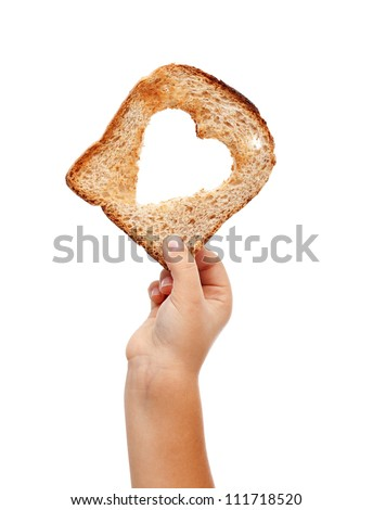 Sharing food with love - child hand with a slice of bread, isolated - stock photo