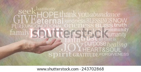Sharing Love - Female hand outstretched with the word LOVE floating above, surrounded by love related words on a wide pastel colored rustic stone effect background - stock photo